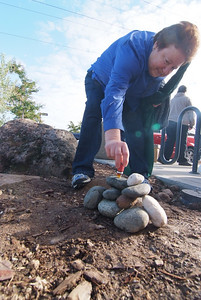 "Adding anointing oil to the memorial stones brought over from the old campus as we ""crossed over!"""