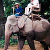 Eric Wright & Nancy Wright Riding on an Elephant to a Hmong Village