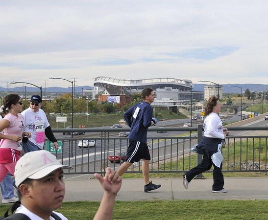 runners and Invesco Field