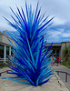 The Denver Botanic Gardens hosts an exhibit by Dale Chihuly, a famous glass artist.  Fantastic glass and neon arrangements are placed in the gardens.