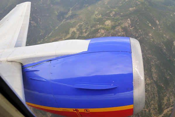 The fusalage of the plane is reflected in the engine cowling - over the Rockies nearing Denver.