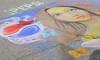 Chalk painting on the street at Larimer & 14th street.
