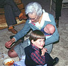 Maternal grandmother Thelma feeding Glenn, with an assist from Cameron, April 1979