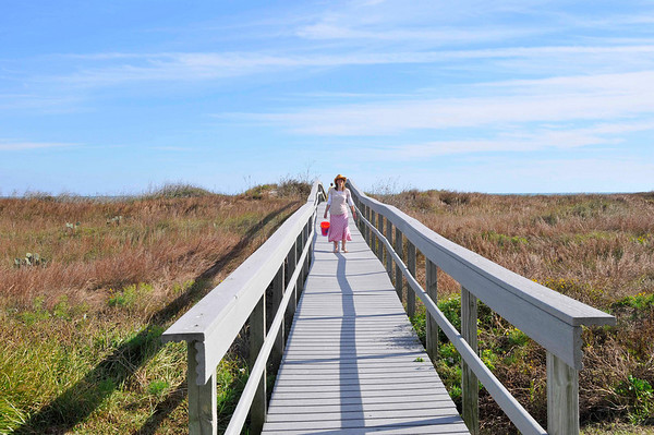 Katie on boardwalk over the dunes to the beach