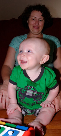Wyatt @ 7months:  happiness is a new toy I can bang on