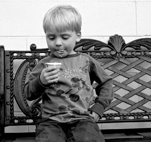 LUCIEN JOHNSON EATING ICE CREAM CONE