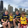 MEANWHILE, BACK IN CHICAGO, THE GRANDKIDS ENJOY CRUISING THE LAKEFRONT ON SEAN'S 36' CRUISER