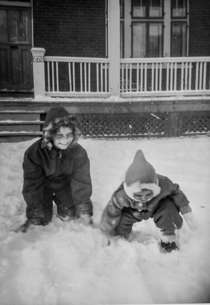 Our St Lambert home, 270 Green Street. John (3 yrs) playing in winter of 1945 with Philip (9) He went to camp in August of '46 and came down with polio. Rushed to hospital, but sadly was overcome by polio a few days after treatment in an iron lung.