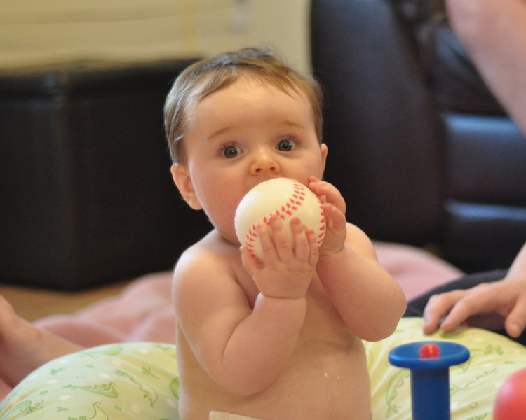 Mom brought out the baseball thingie.<br /> And, of course, I have to taste it.