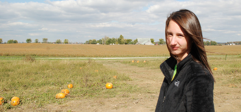 The thoughtful pose.... where, oh where, is the perfect pumpkin... I must find it before my sisters!