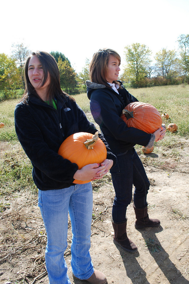 Anybody seen that good lookin' tractor driver pullin' a pumpkin wagon? We could use a ride back to the orchard....