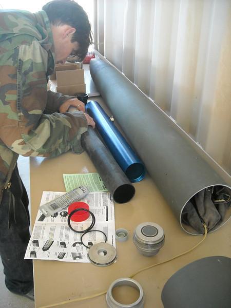 Cal-Poly Pomona 2012 USLI student installing propellant grains.