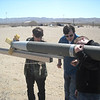 Cal-Poly Pomona 2012 USLI students loading rocket on rail for launch.