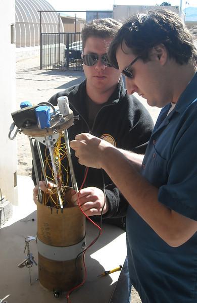 Cal-Poly Pomona students assembling avionics package to 2012 USLI rocket.
