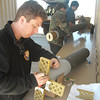 Cal-Poly Pomona 2012 USLI student installing 'grid fins'.