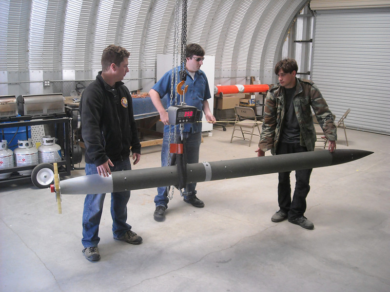 Cal-Poly Pomona 2012 USLI students weighing rocket and verifying Cg of rocket.