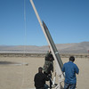 Cal-Poly Pomona 2012 USLI students using hydraulic pump to raise rocket into position for firing.