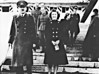 ADOLF HITLER  AND EVA BRAUN - Probably shot late in the War as they were rarely seen in public together - note that the Fuehrer is walking with a stick and Eva Braun, ever the photographer's assistant, carriers a very neat-looking little camera.