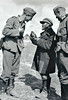 FRATERNISING WITH THE LOCALS - Two soldiers interrogate what must be a Russian peasant. Is he trying to sell them his watch?