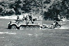 HALF-TRACK IN THE RIVER - An SD Kfz9 heavy half-track tows an artillery piece, probably a 75mm piece, through a river.