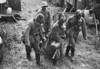 GAS ATTACK! - Soldiers practice evacuating a casualty under gas attack in what is, I suspect, a pre-war exercise. The use of poison gas was much feared during the War but never used in combat.