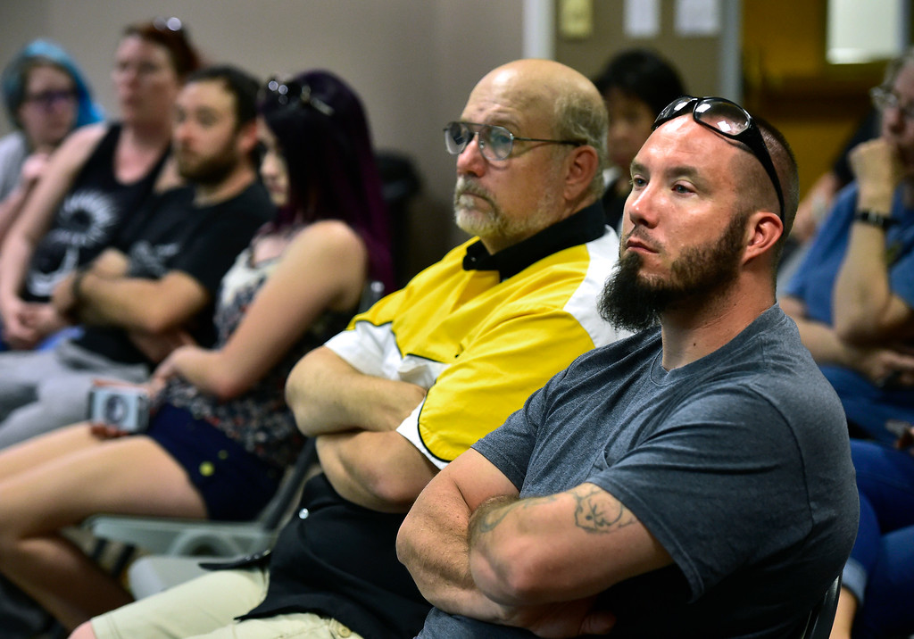 . LONGMONT CO AUGUST 4, 2018 Mark Rosneck, left, and Brian, who declined to give his last name, listen to speakers during a seminar for FASTER the Faculty / Administrator Safety Training & Emergency Response at the Longmont Public Library on Saturday August 4 2018 Paul Aiken Staff Photographer August 4, 2018
