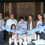 Om Patel cut the ribbon as members of his family looked on.
