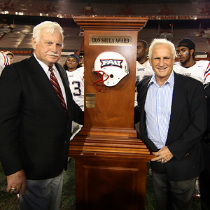 Don Shula, at right, presenting his football award to Howard Schnellenberger, Head Coach of FAU's football team. Each year FAU is paired with FIU for possession of this trophy for the year. FAU being victorious again, will hold possession of this award for another year, this the 4th victory of its 5 year heritage.