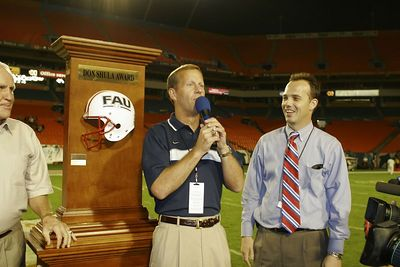FAU President Frank Brogan speaking at Pro Player Stadium with Craig Angelos FAU Athletic Director