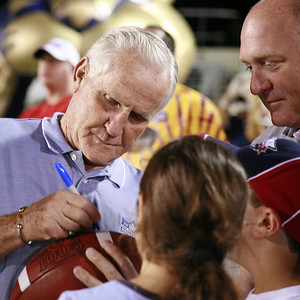 Don Shula signing a football at FAU vs FIU football game November 26, 2005. The image was taken with Canon 5D with Canon's new 24-105mm IS f4 Image Stabilized lens.