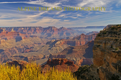 This particular shot across the Grand canyon was one of my favorites. I laid down near the edge and shot through this Grass as the sun started dropping low enough to produce some shadows. The different colors of rock as well as the wind scattered clouds took my breath away.  Look at those low clouds under the rim in the upper right frame.