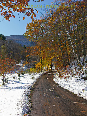 This country lane also near the lodge has a great view of the hills and the fall colors with the surprise addition of some October Snow.