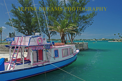 This brightly colored boat was one of many to dot the docks around Bermuda. Check out that sky and sea!