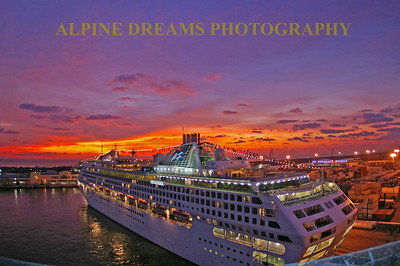 This CRUISE SHIP at DAWN was taken in Tampa Fl. The sky was lit up like fireworks.