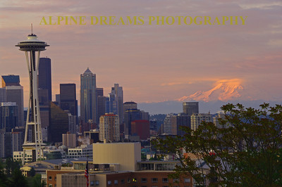 I call this View from Kerry Park.  The Space needle jumps out at you at 5:30 AM on the last day of May. Check out the pink and purple hues around the majestic Mount Rainier!