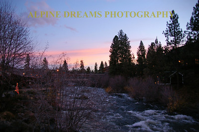 10       Not all of the beautiful scenery is on the mountain.  This was taken at DAWN  just outside my room in BEND  at the RIVER HOUSE Hotel.   Check out the Pink Sky, the christmas tree, and the Raging River.   BEND OREGON has lots to offer  Unfortunately I had no free time to tour Bend with my camera.     Guess I Have to go back!