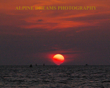 I call this one of my painted sunset shots. I was on the deck of a 50 foot Catamaran and the rock and roll was pretty evident. I bumped the ISO up enough to get the shot but it came out more like a painting. The colors were awesome!