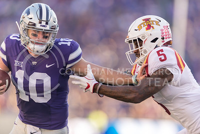K-State freshman quarterback Sklyar Thompson holds back Iowa State defensive back Kamari Cotton-Moya during the football game against Iowa State at Bill Snyder Family Stadium on Nov. 25, 2017. (George Walker | Collegian Media Group)