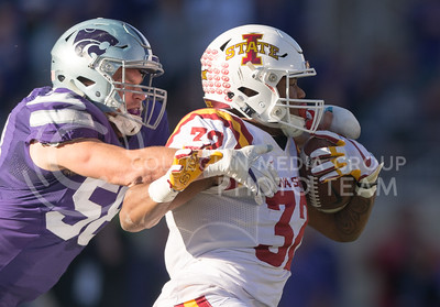 Iowa State running back David Montgomery is tackled by K-State senior linebacker Trent Tanking during the football game between K-State and Iowa State at Bill Snyder Family Stadium on Nov. 25, 2017. (George Walker | Collegian Media Group)