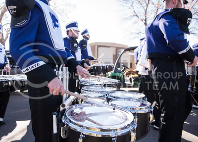 The Kansas State Wildcat Pride Marching Band marches to Bill Snyder Family Stadium for the home game against the Iowa State Cyclones in Manhattan, Kan., on Nov. 25, 2017. (Olivia Bergmeier | Collegian Media Group)
