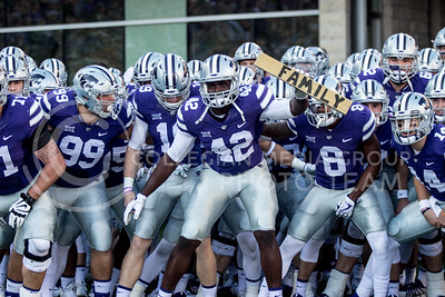 Junior defensive end Osvelt Joeseph holds the family block during the pregame of the football game against Iowa State at Bill Snyder Family Stadium on Nov. 25, 2017. (Alanoud Alanazi | Collegian Media Group)