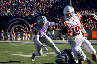 Freshman running back Tyler Burns chases after an Iowa State player during the football game at Bill Snyder Family Stadium on Nov. 25, 2017. (Alanoud Alanazi | Collegian Media Group)