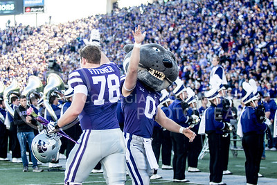 Senior offensive line Bryce Fitzner high fives Willie during the pregame of the football game against Iowa State at Bill Snyder Family Stadium on Nov. 25, 2017. (Alanoud Alanazi | Collegian Media Group)