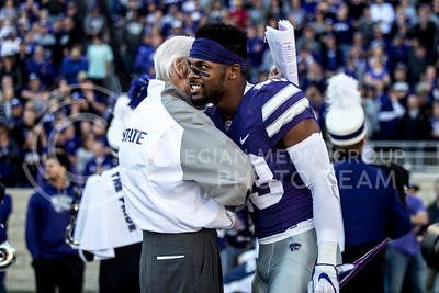 Bill Snyder talks to senior defensive back Cre Moore  during the pregame of the football game against Iowa State at Bill Snyder Family Stadium on Nov. 25, 2017. (Alanoud Alanazi | Collegian Media Group)