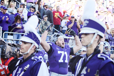 Kansas State University football players celebrate their win against Iowa State University at Bill Snyder Family Stadium in Manhattan, Kansas on Nov. 25th, 2017. (Photo by Emily Lenk  | Collegian Media Group)