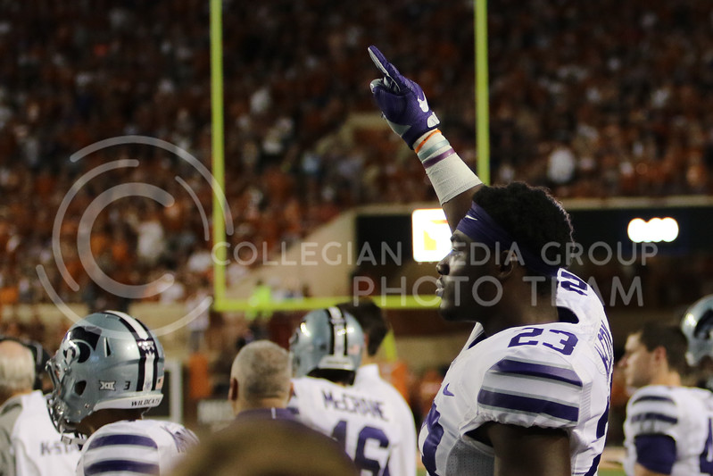 AUSTIN, TEXAS - OCTOBER 7: K-State defensive back Mike McCoy #23  holds up his hand before a kick off during the football match between Kansas State University and University of Texas, Austin at Darrell K Royal Stadium on October 7th, 2017. (Photo by Cooper Kinley | Collegian Media Group)