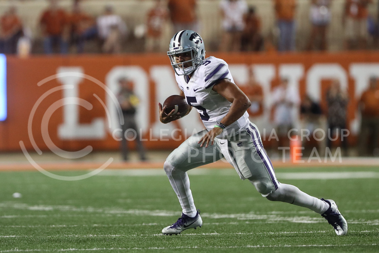 AUSTIN, TEXAS - OCTOBER 7: K-State quarter back #5 Alex Delton rushes the ball during the football match between Kansas State University and University of Texas, Austin at Darrell K Royal Stadium on October 7th, 2017. (Photo by Cooper Kinley | Collegian Media Group)