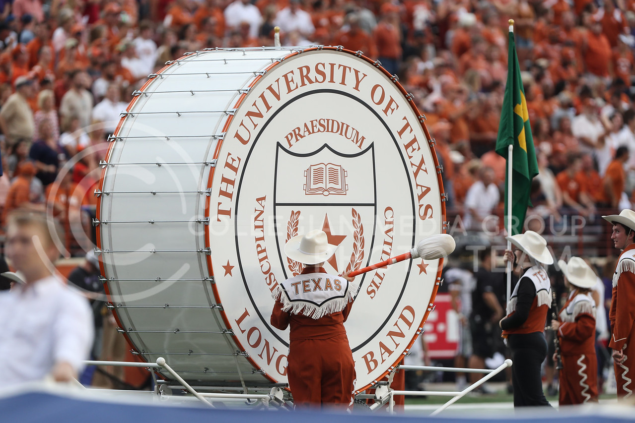 AUSTIN, TEXAS - OCTOBER 7: The Longhorn Band beats an oversized drum before the football match between Kansas State University and University of Texas, Austin at Darrell K Royal Stadium on October 7th, 2017. (Photo by Cooper Kinley | Collegian Media Group)