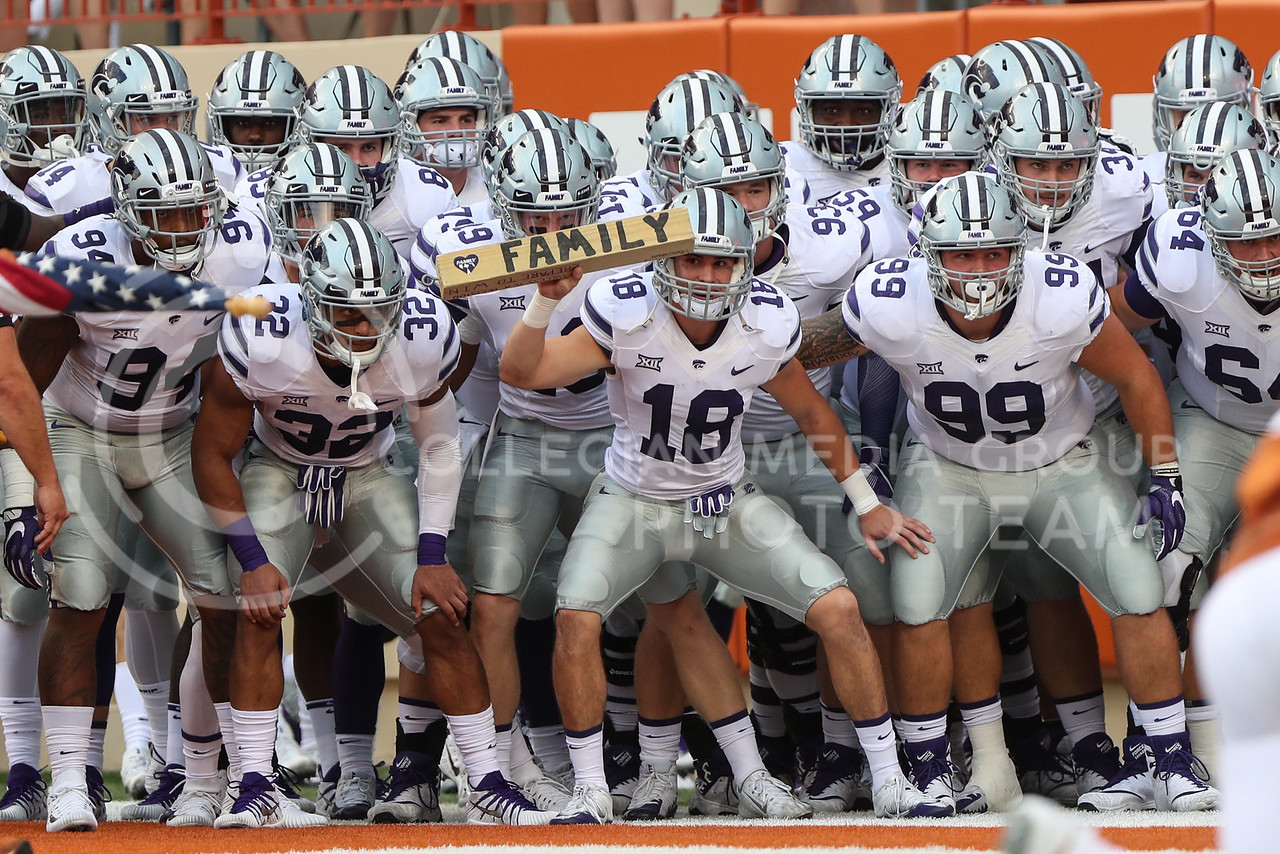 AUSTIN, TEXAS - OCTOBER 7: K-State #18 holds up the Family Block prior to kickoff during the football match between Kansas State University and University of Texas, Austin at Darrell K Royal Stadium on October 7th, 2017. (Photo by Cooper Kinley | Collegian Media Group)