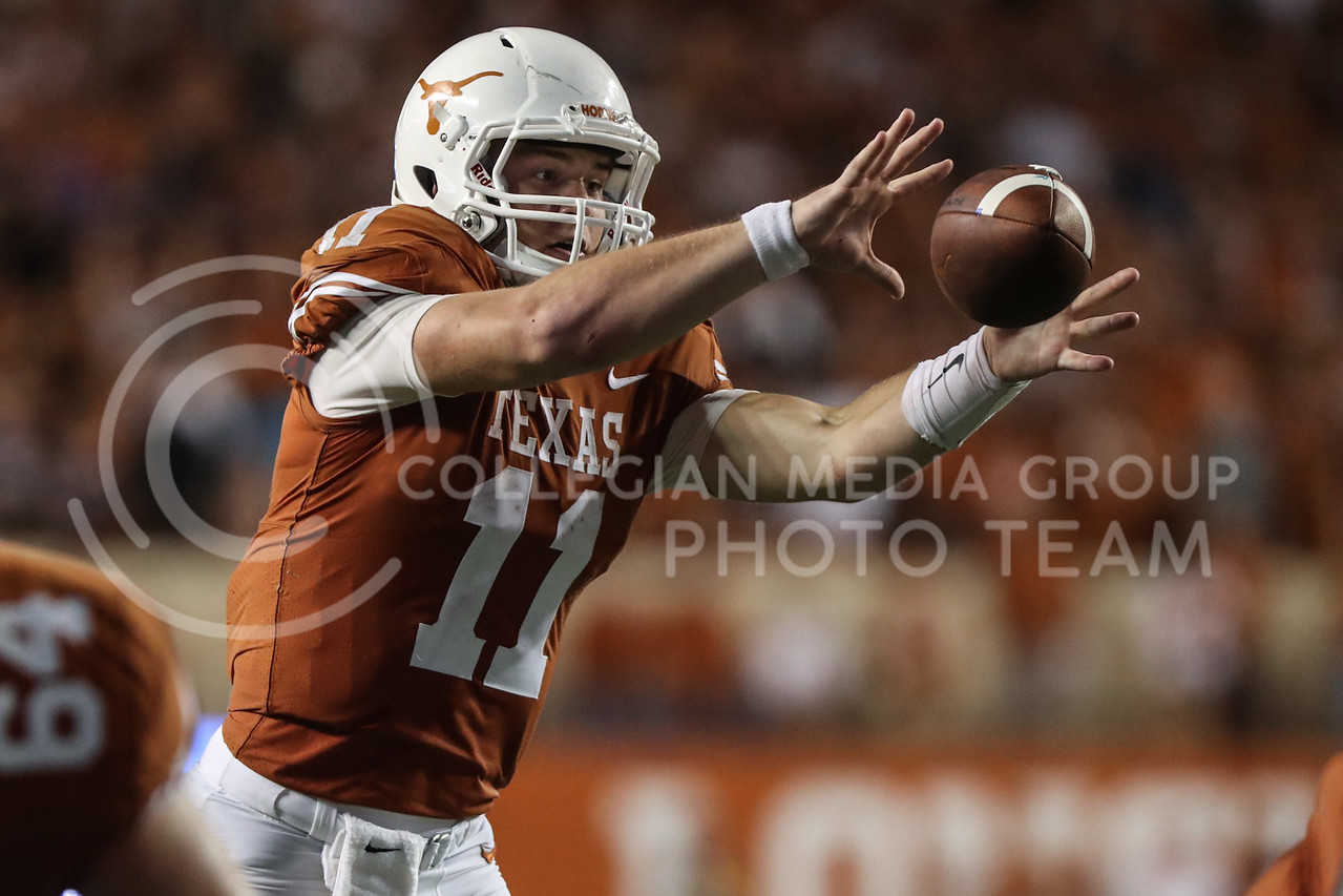 AUSTIN, TEXAS - OCTOBER 7: UT Austin quarter back #11 Sam Ehlinger catches a snapped ball during the football match between Kansas State University and University of Texas, Austin at Darrell K Royal Stadium on October 7th, 2017. (Photo by Cooper Kinley | Collegian Media Group)